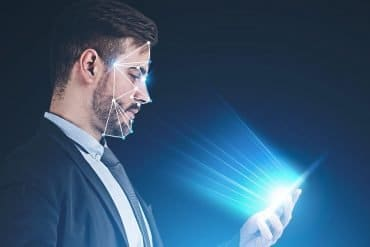 Man using facial recognition technology on mobile phone showing the privacy concerns over facial recognition technologies