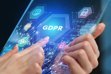 Man touching GDPR icon on virtual screen showing the future of data breach fines