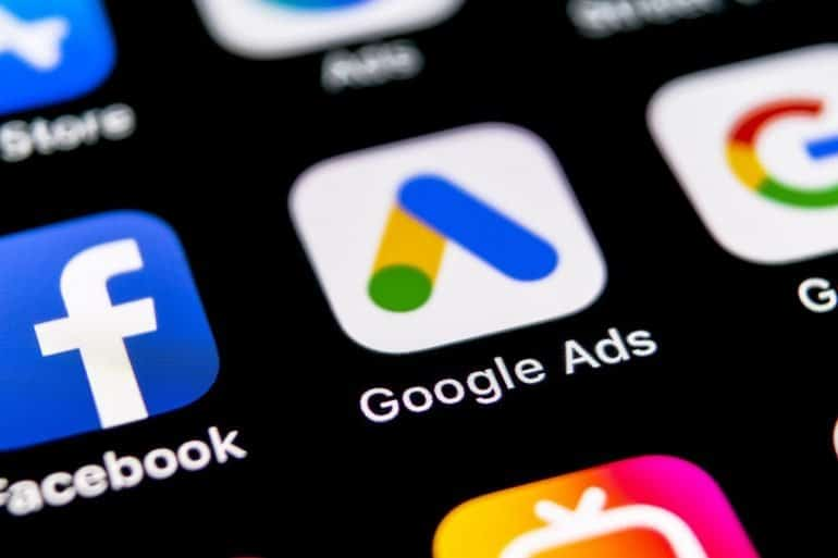 Google Ads icon on mobile phone showing Google's proposed privacy standards remain friendly for programmatic advertising