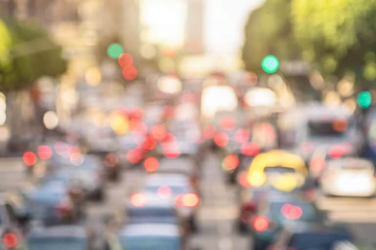 Rush hour traffic jam showing state DMV offices selling personal data for millions of dollars in profit