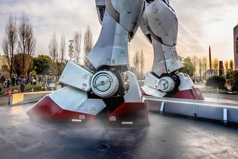 Giant robot standing in city showing U.S. opening new antitrust probe into Big Tech firms
