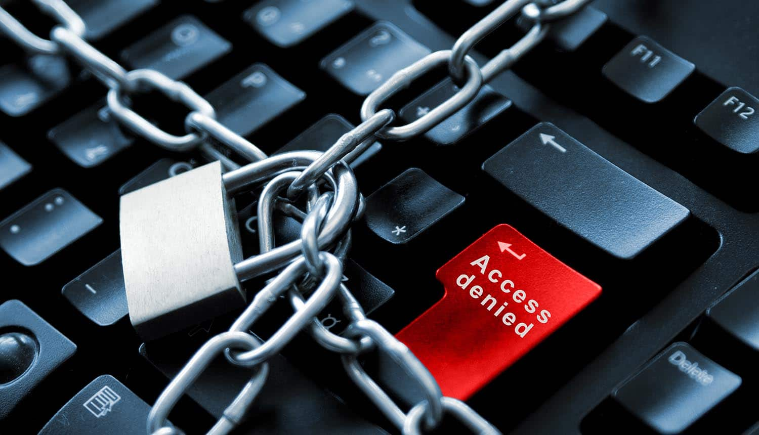 Internet security concept by chain with padlock keyboard showing the dangers of leaked passwords