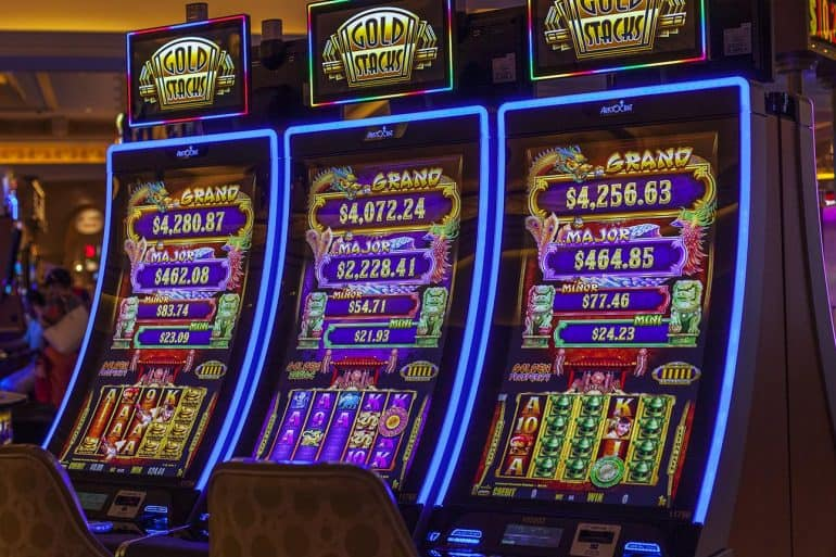 Slot machines in casino showing the return of ATM malware and jackpotting attacks