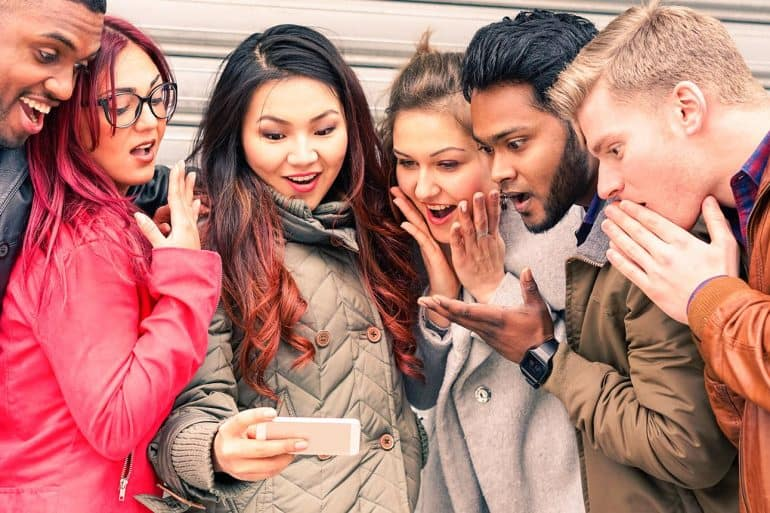 Few persons with surprised face looking at mobile showing majority of Americans have little knowledge on digital security and privacy as shown in new study