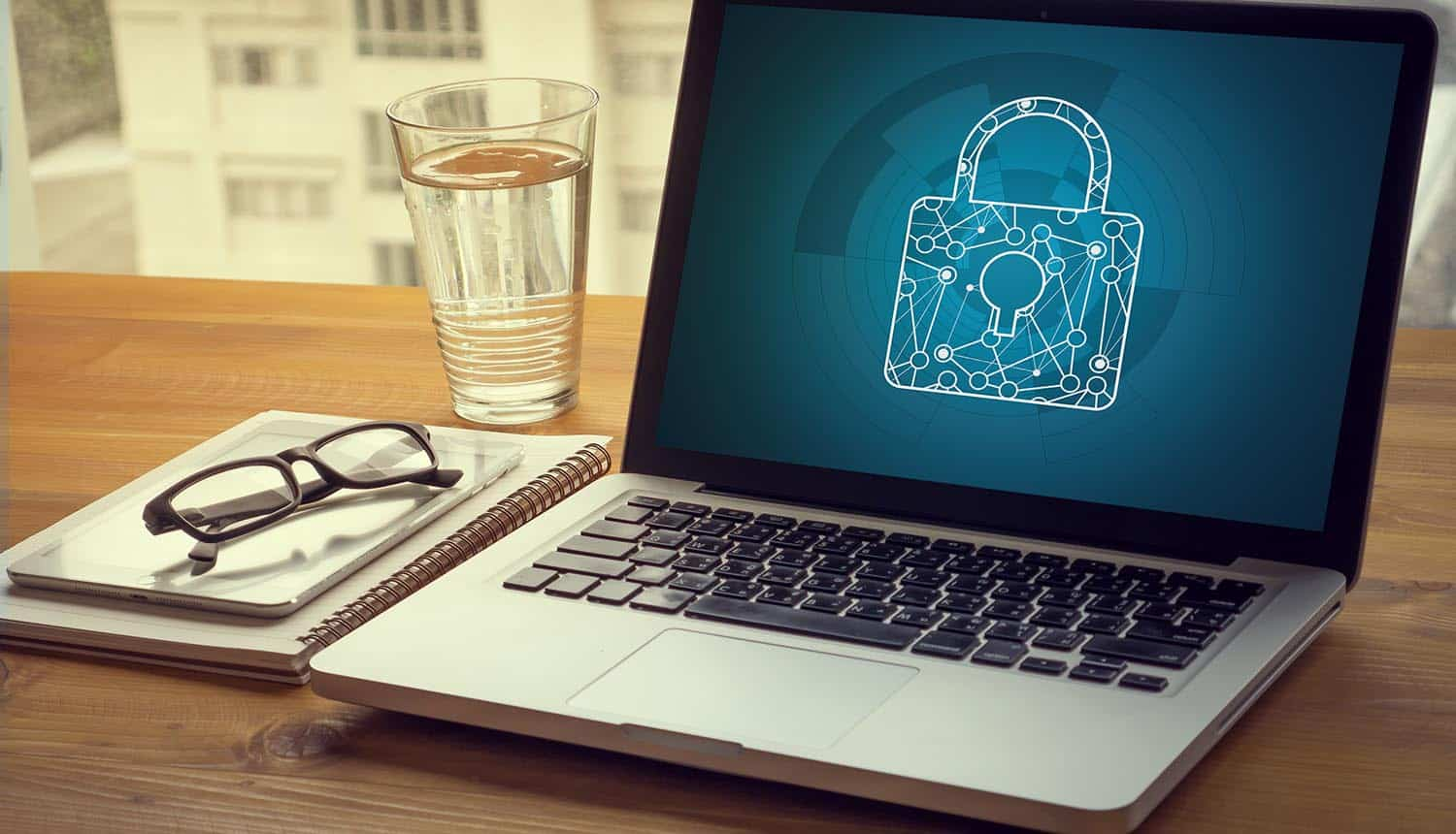Padlock icon on laptop screen showing 70% of presidential candidates failing at consumer privacy as shown in OTA report