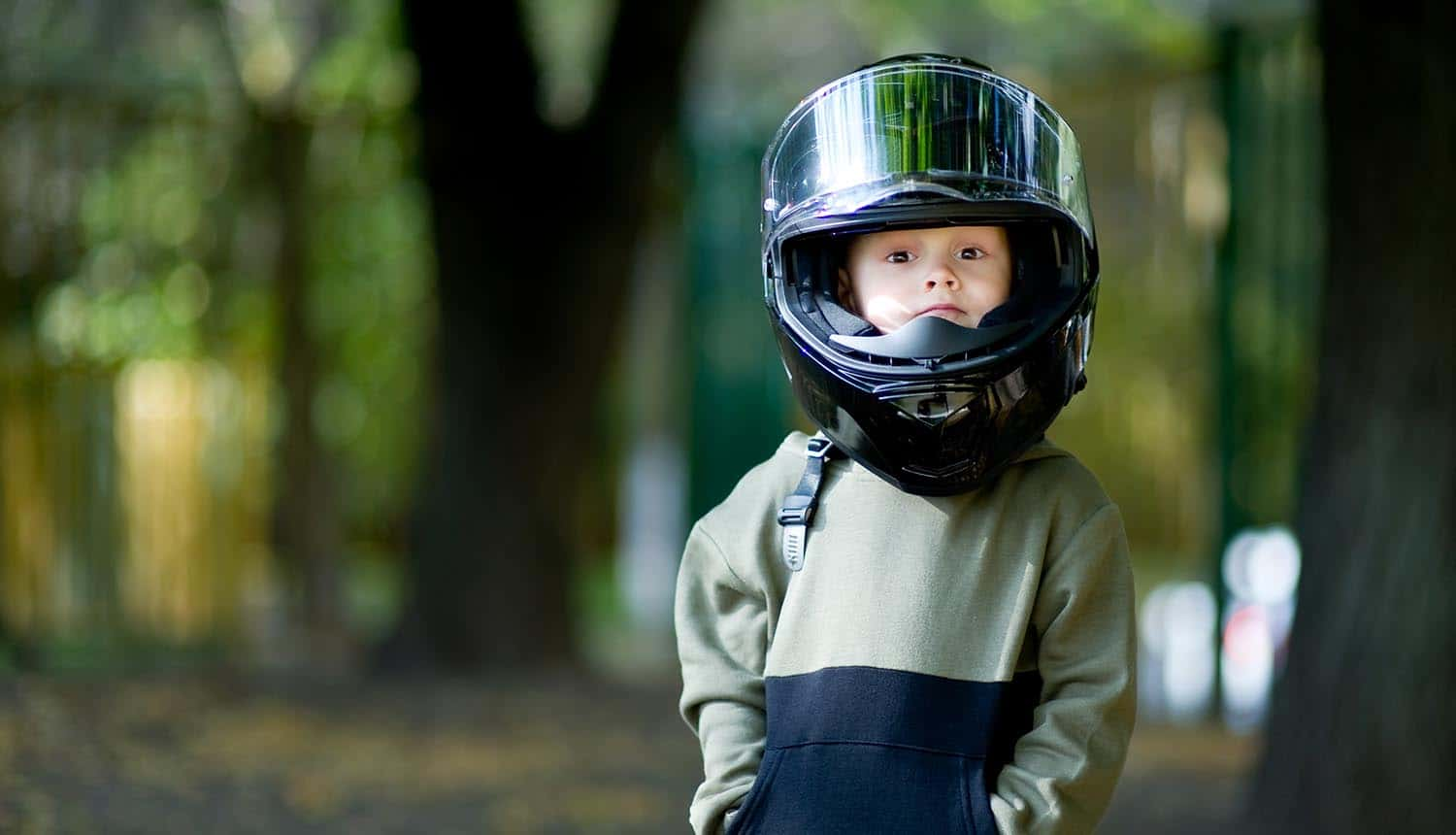 Kid with a big motorcycle helmet on his head showing politicians warning FTC against weaking COPPA