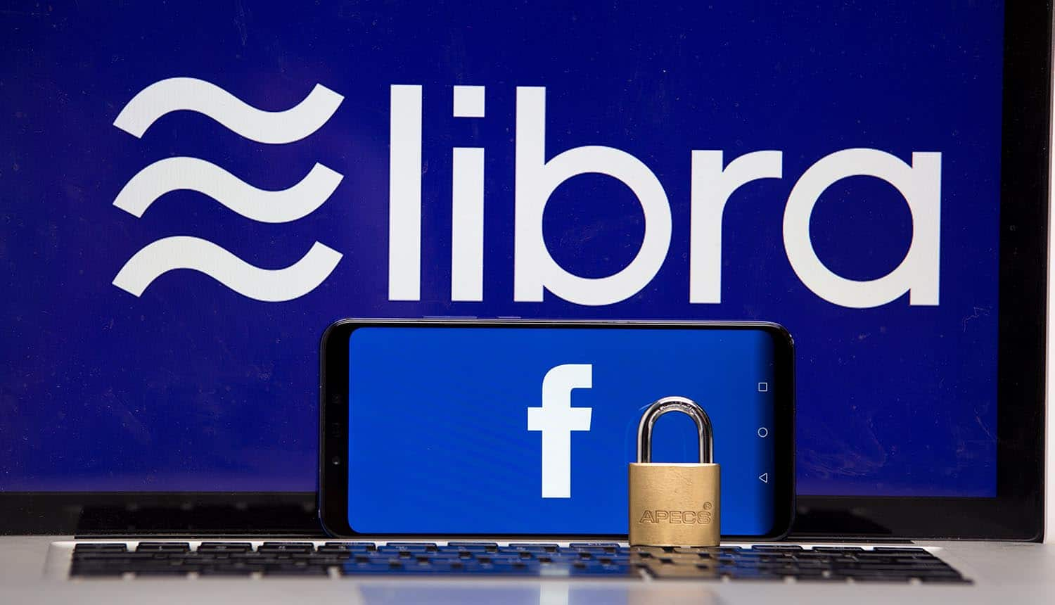 Libra Coin and Facebook on the phone and computer screen showing what it means for cryptocurrency