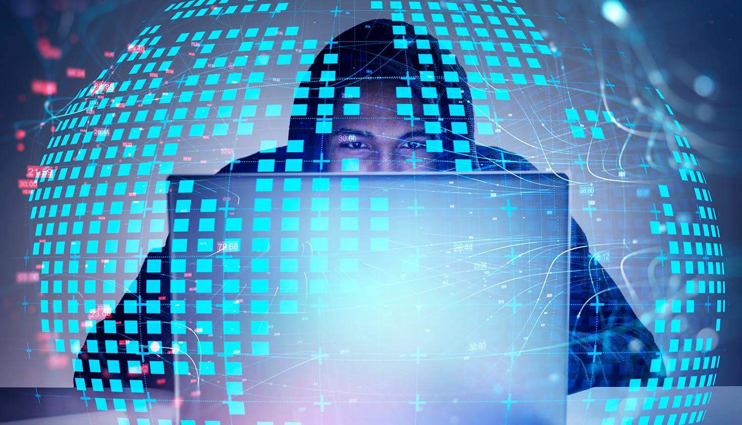 Hacker working on laptop showing how the breach of leading domain name registrar could lead to an explosion in phishing scams