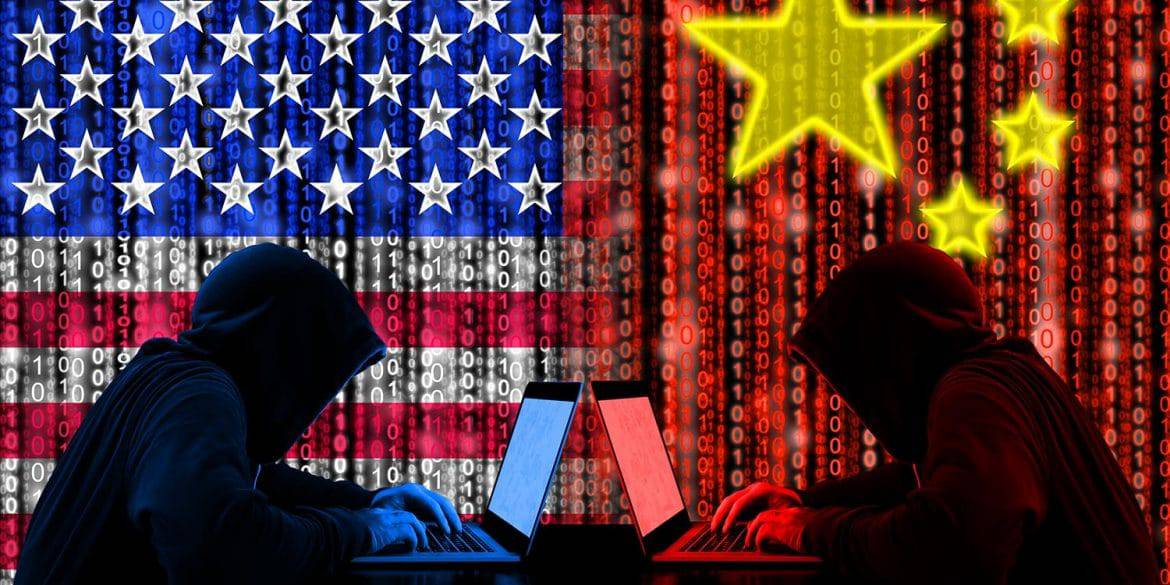 American hacker sitting opposite of a chinese hacker showing the Chinese cyber threat to national security