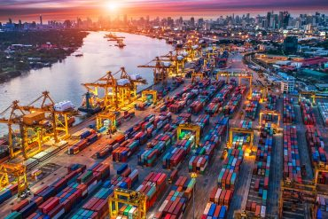 Containers and cargo ships in shipyard showing the potential cost of cyber attack on Asia-Pacific ports at $110 billion