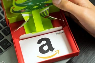 White color Amazon gift card in red box showing danger of gift card fraud