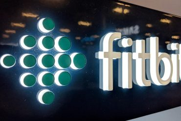 Fitbit logo on shop front showing the implications for health and fitness data from Google's acquisition of Fitbit