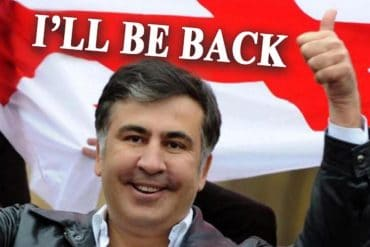 "Picture of former Georgian president Mikheil Saakashvili with ""I'll be back"" banner showing new concerns for politically motivated cyber attacks over the massive web defacement attack in Georgia"