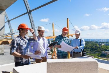 Group of builders on construction site showing preparation for CCPA privacy law
