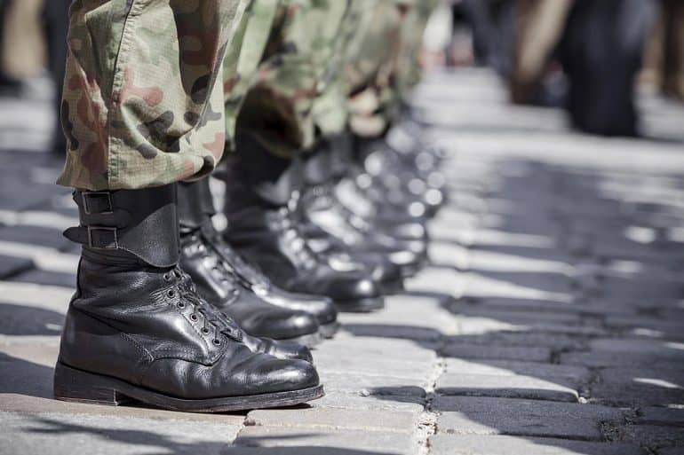 Close-up of boots at parade showing the U.S. National Guard defending against cyber attacks