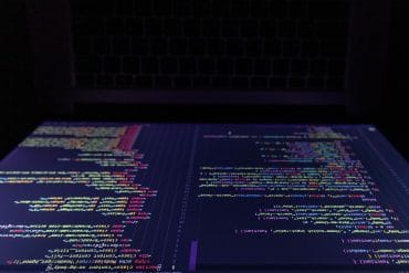 Programming codes on laptop screen showing 98% of top U.S. websites are susceptible to client-side attacks
