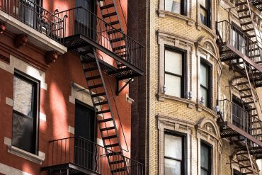 Building with fire escapes showing the impact of GDPR on commercial real estate industry