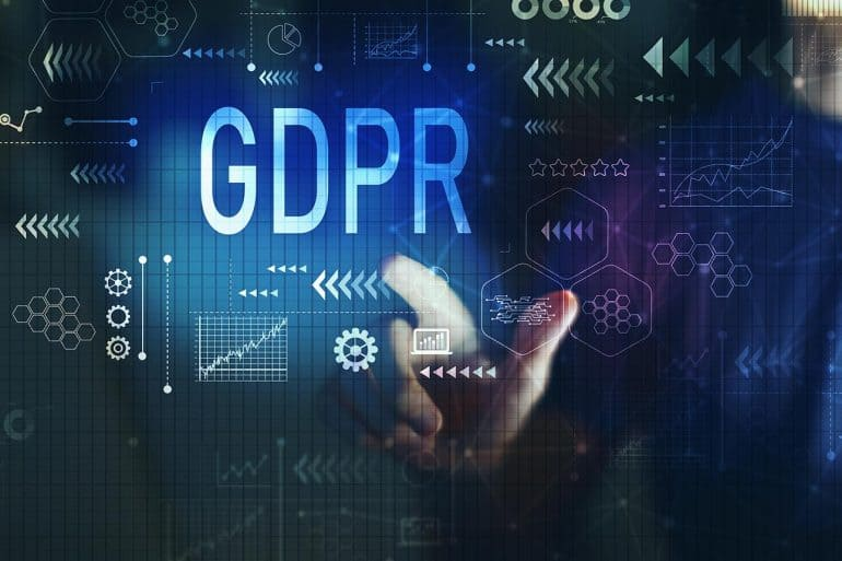 Man touching GDPR word on virtual screen showing the costs and benefits that GDPR and CCPA compliance can bring to companies