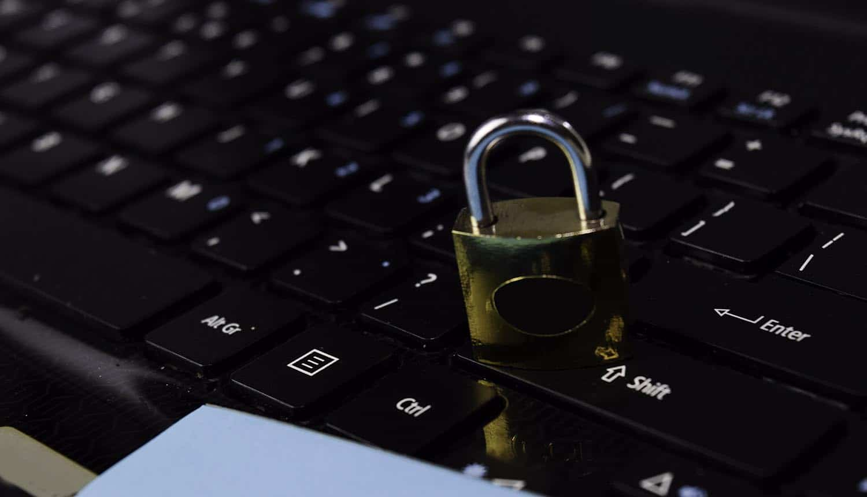 Padlock on laptop keyboard showing another Ryuk ransomware attack on Louisiana state