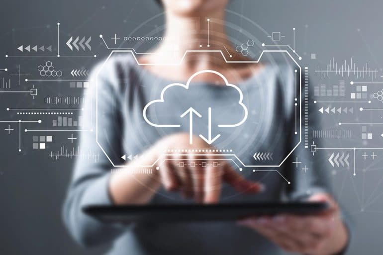 Woman using tablet with cloud icon showing multi-cloud security as new number one IT challenge for businesses