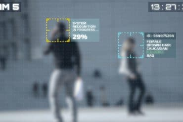 Facial recognition technology running on people in city showing the NIST face recognition study which found that algorithms vary greatly between software vendors