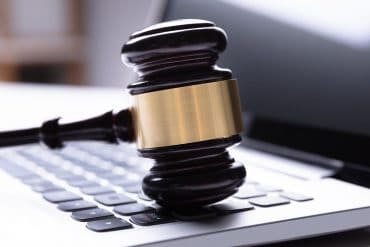 Close-up of wooden gavel on laptop showing new COPRA digital privacy act