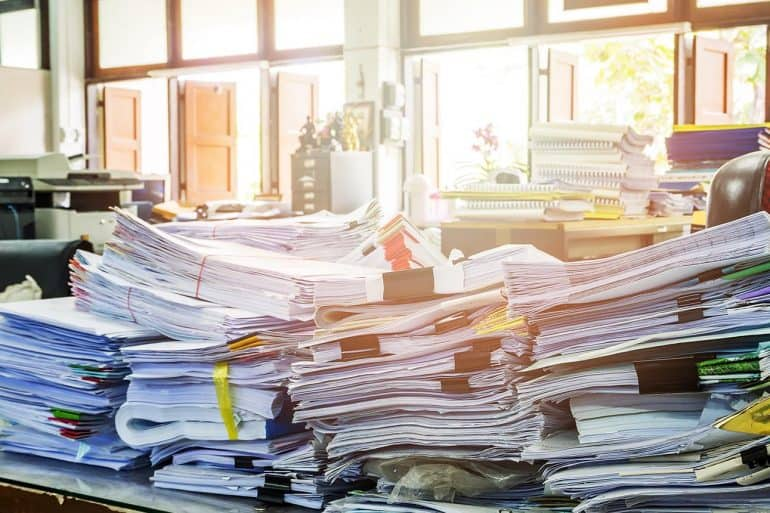 Close up of customer contracts stack on desk showing WeWork exposure