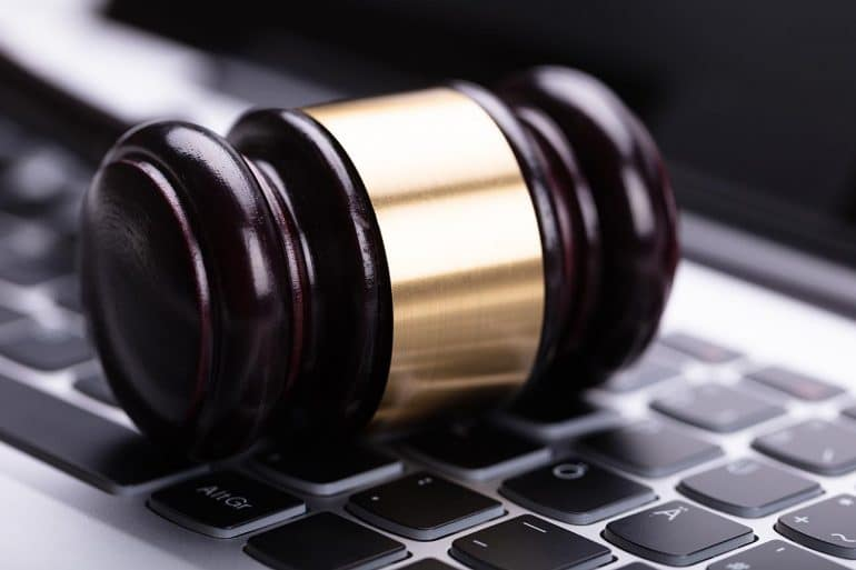 Wooden gavel on laptop keypad showing the possibility of CCPA leading to a national privacy law