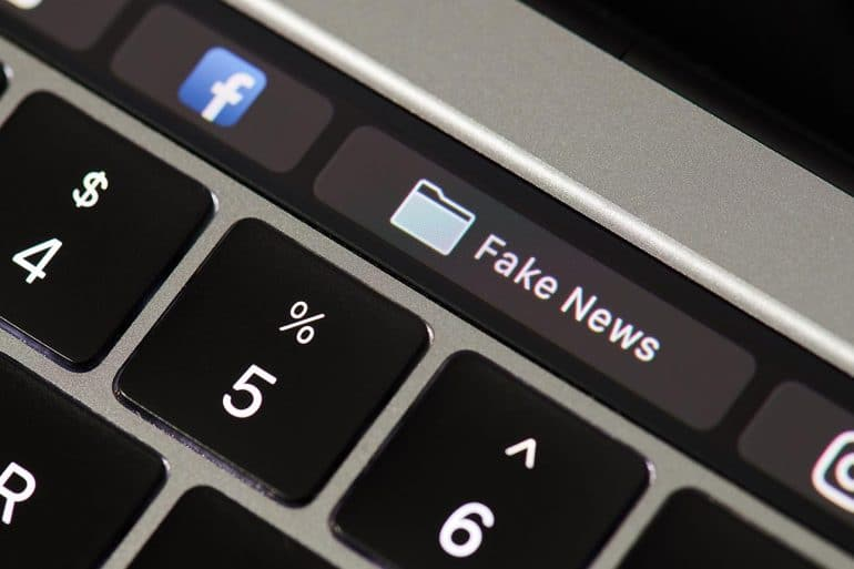 Keyboard with Facebook and fake news buttons showing Facebook ban of deepfake videos ahead of 2020 election