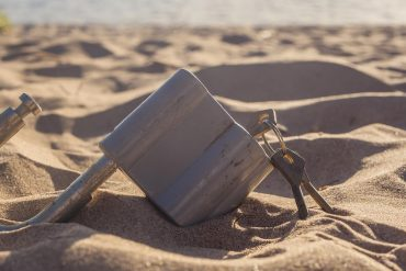 Close up of metal lock with keys in the sand showing proposed privacy sandbox to phase out third party cookies