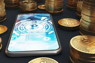 Close up of a smartphone with bitcoins showing security of cryptocurrencies