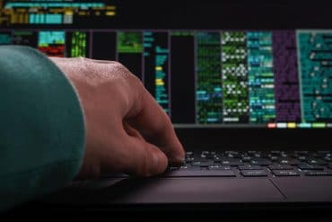 Hacker hands at work showing risk of Iranian cyber attack