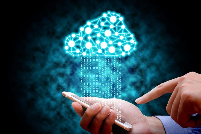 Man using mobile phone connecting to cloud network showing government agencies using cloud extraction tools as surveillance technology