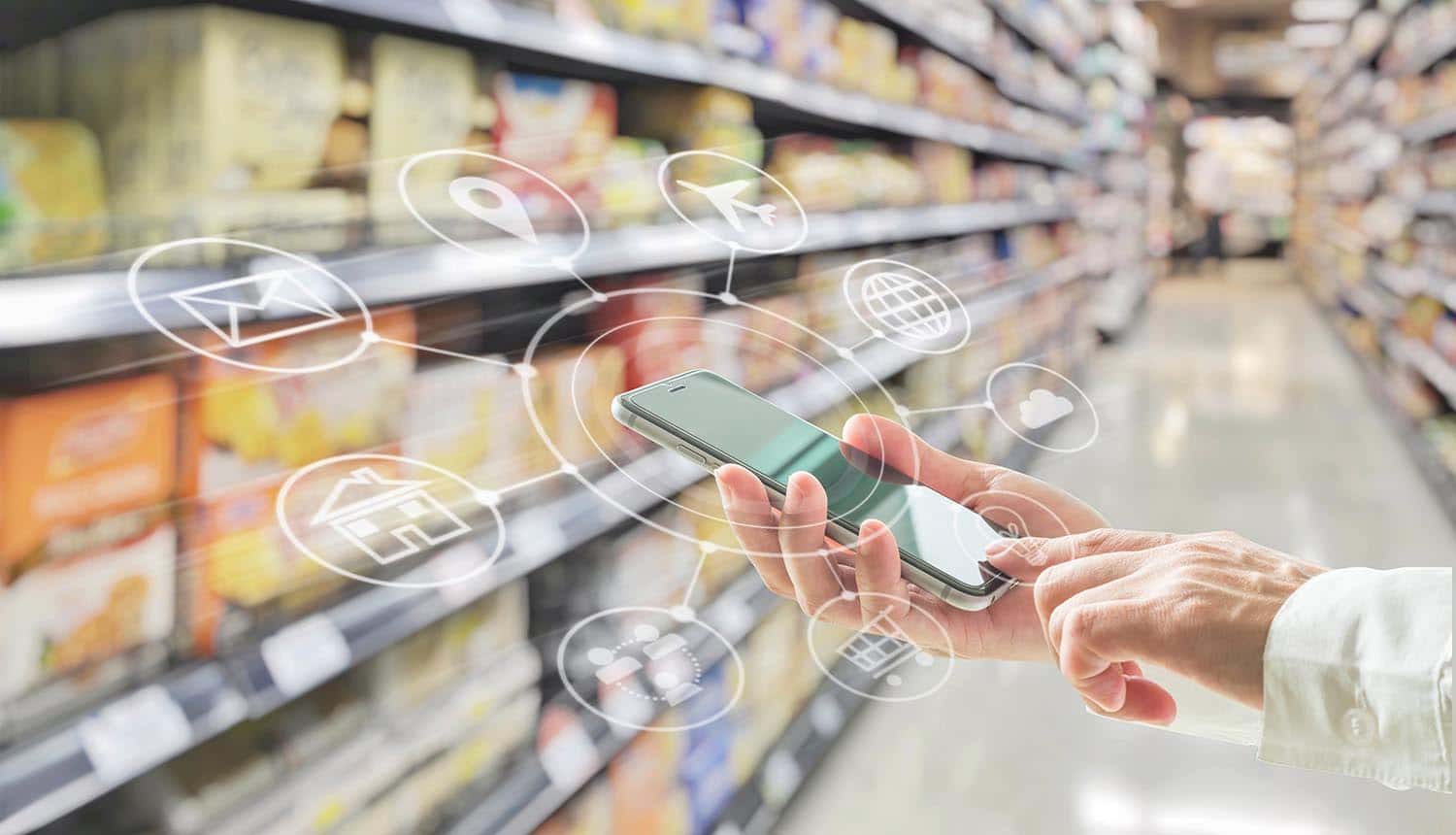 Man in supermarket showing use of IoT payments