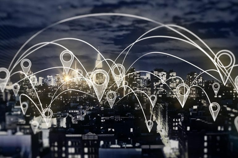 Network map over city night view showing the future of location data and smartphone tracking