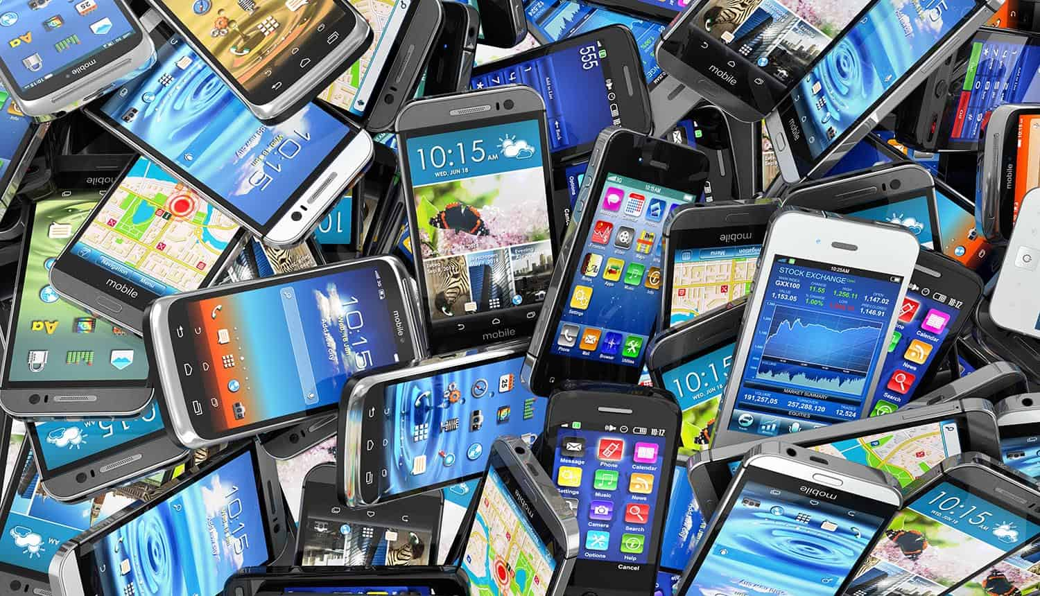 Pile of smartphones showing the pre-installed malware that comes with U.S. government-funded Android phones