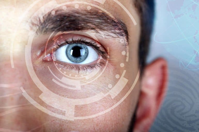 Biometric identification on man's eye showing the technologies to protect digital identity