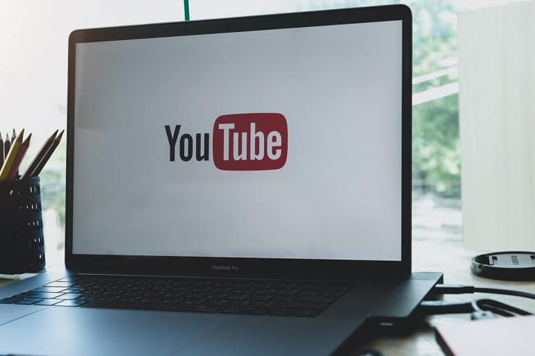 YouTube logo on laptop screen showing YouTube's new privacy rules for COPPA compliance