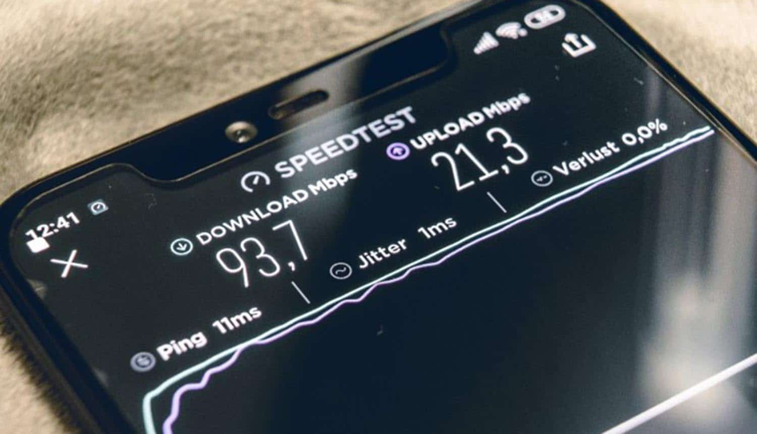 Mobile phone doing speed test showing 5G security concerns