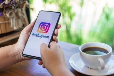 Man using Instagram app on mobile showing the Instagram password leak that exposed 10,000 plaintext credentials