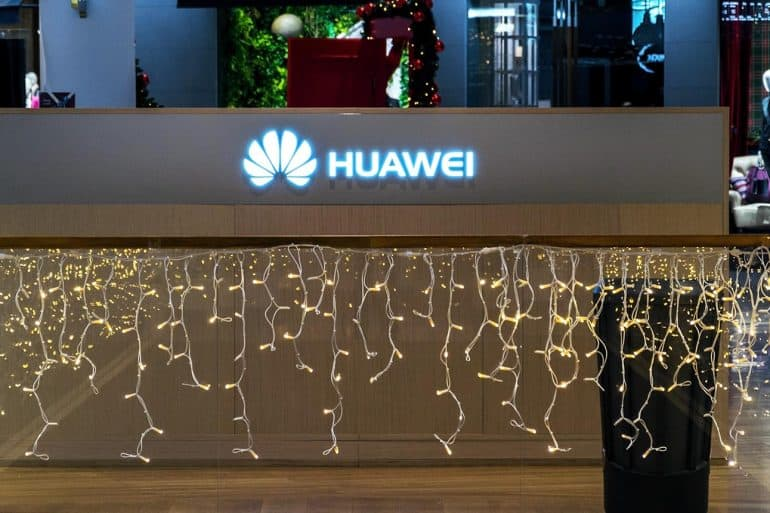 Huawei telecommunications equipment and electronics company logo on mobile phone shop showing the possible retaliation against France for discrimination against Huawei over 5G network equipment