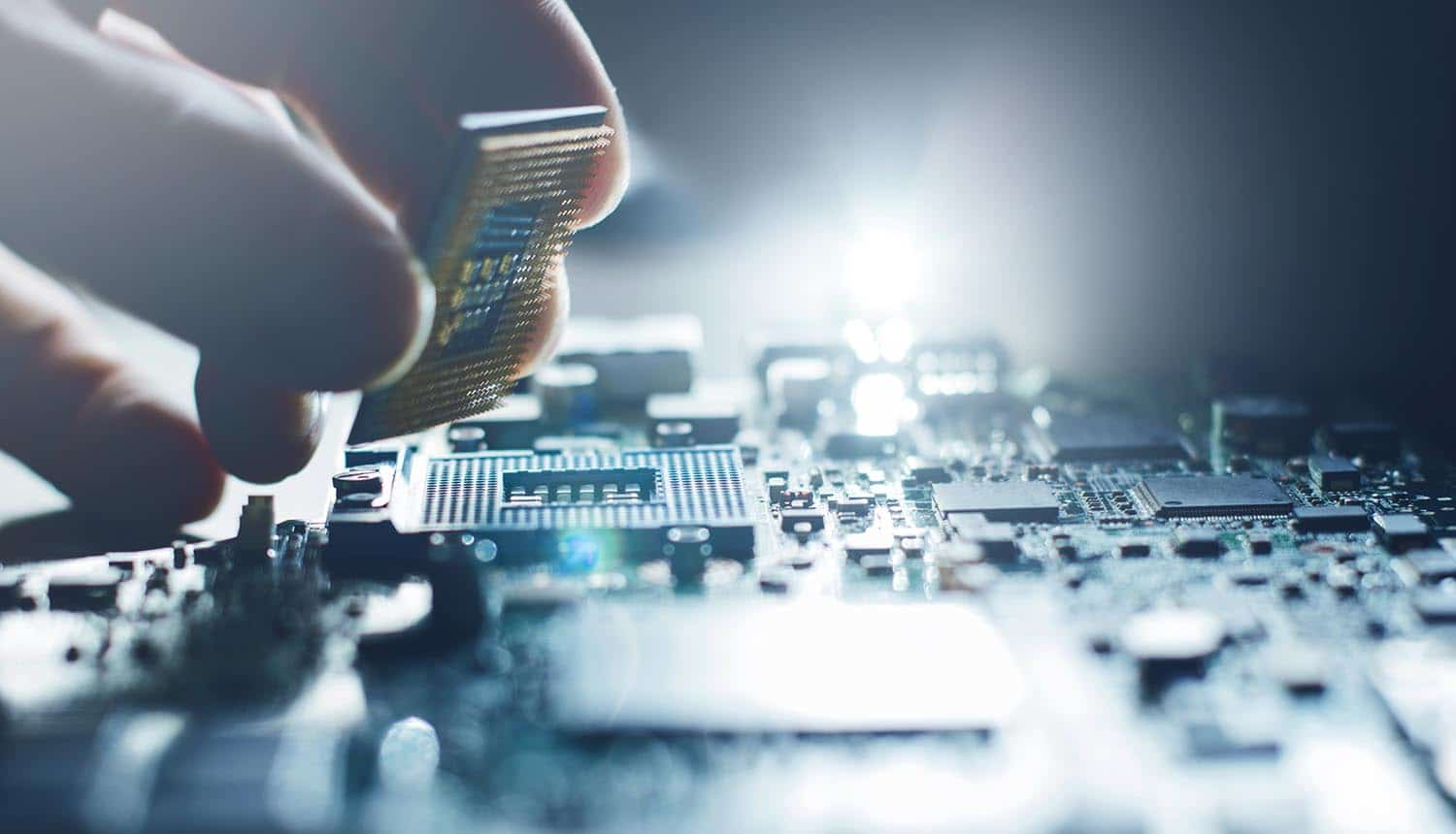 Engineer working on hardware chip on motherboard showing Crypto AG using encryption backdoor on cryptographic equipment for CIA to spy on foreign affairs