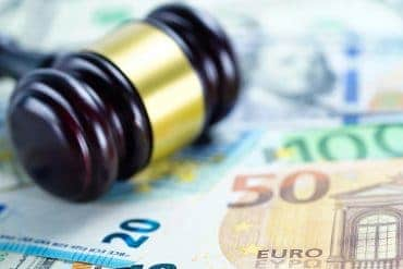 Gavel on Euro dollar notes showing GDPR fines topping $126 million with over 160,000 reported data breaches