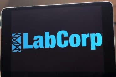 Labcorp company logo on tablet screen showing LabCorp's second data leak in a year that exposed over 10,000 medical records