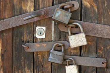 Wooden gate with padlocks showing how cybersecurity could start from home