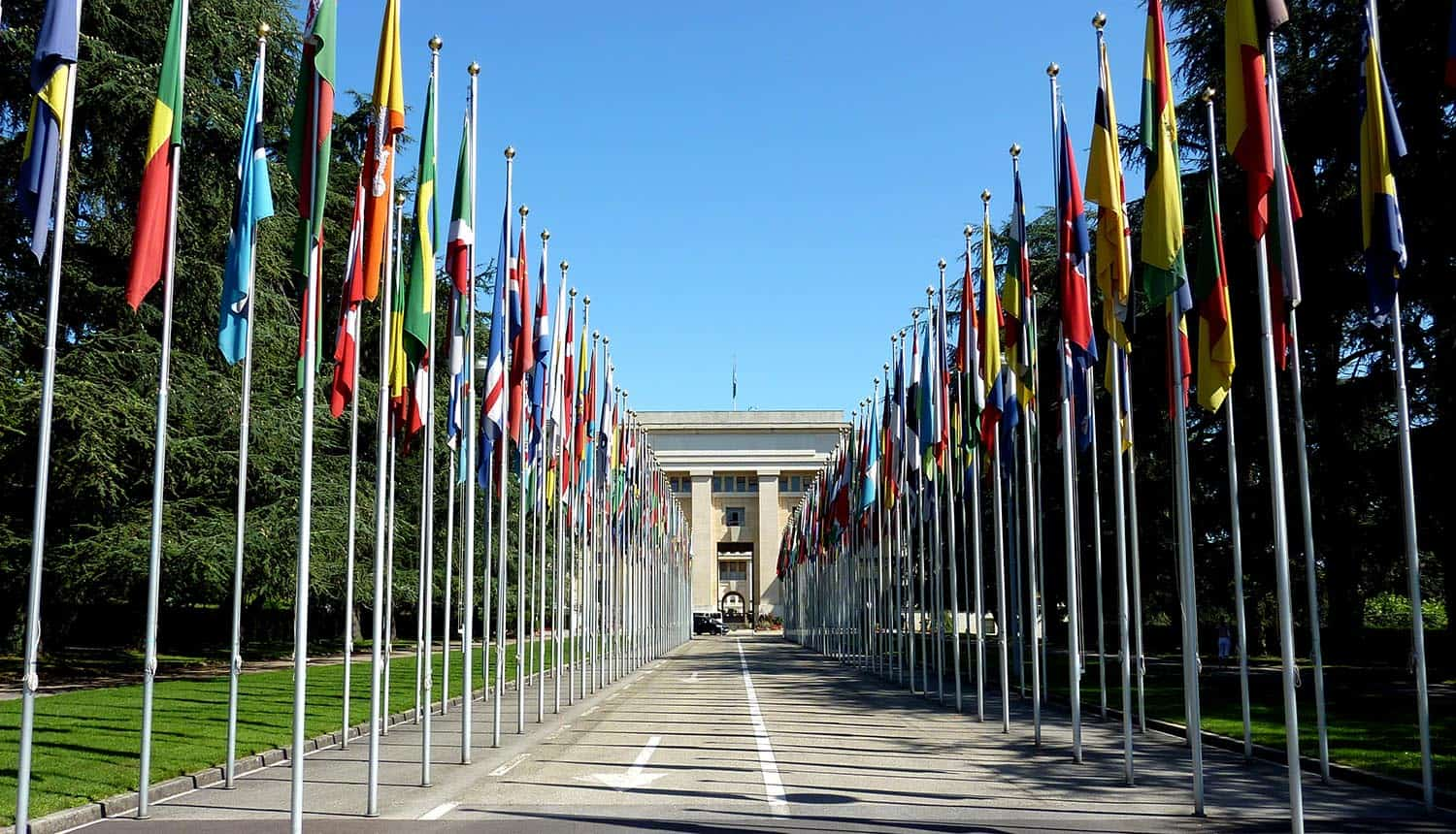 United Nations building with flags showing the UN data breach from unpatched SharePoint vulnerability