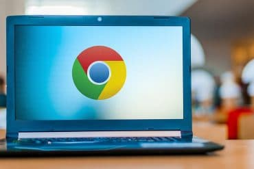 Google Chrome logo on laptop screen showing 500 delisted Chrome browser extensions used in massive ad fraud campaign