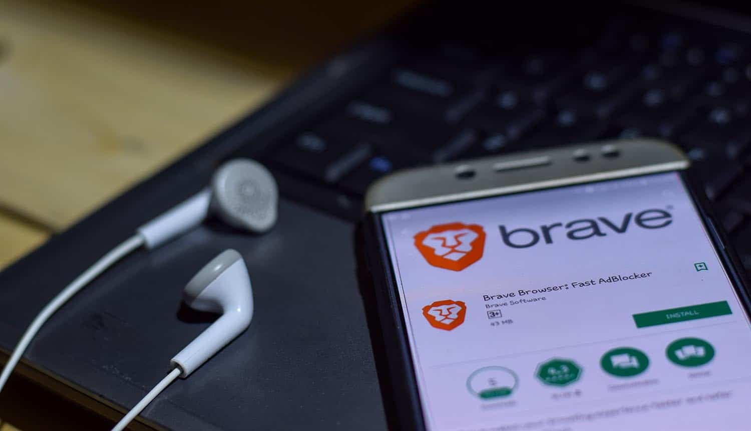 Brave browser on smartphone screen showing study on private browsers and privacy-invading telemetry