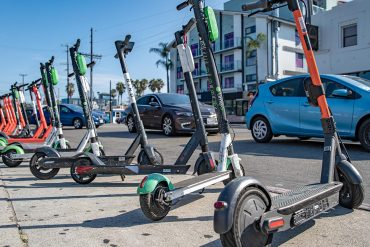 Electric scooters on street showing the collection of mobility data by Los Angeles Department of Transportation