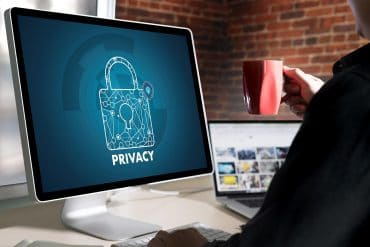 Man in front of screen with privacy lock showing how to protect online privacy